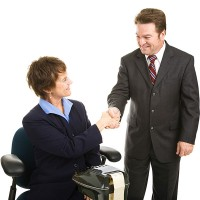 a court reporter shaking hands with an attorney