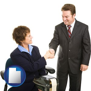 a court reporter shaking hands with an attorney - with Utah icon